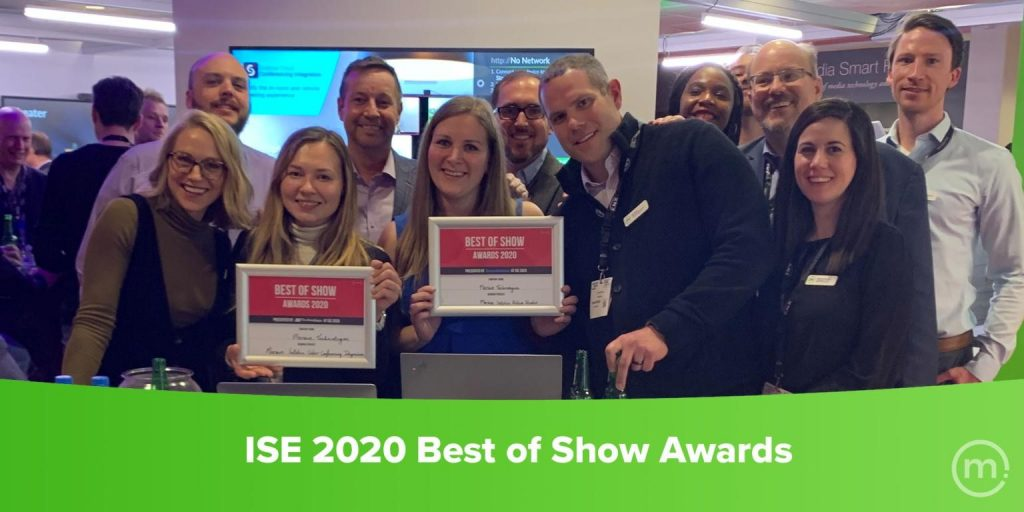 Mersive Team Members holding up two best of show awards at ISE 2020 event.