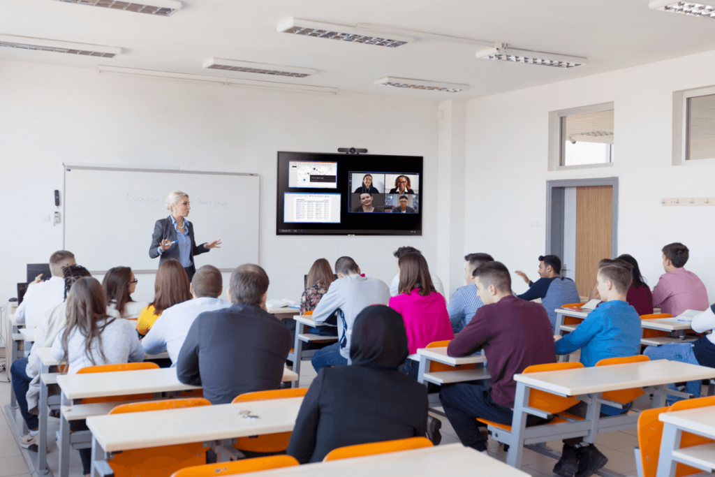 Teacher in medium sized classroom using Conference